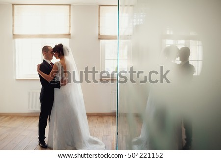Intimate moment for wedding couple