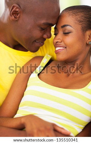 intimate young african couple in love