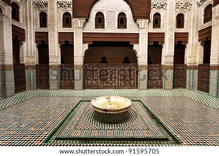 Intricate and symmetrical interior tiled courtyard of Muslim madrasah school
