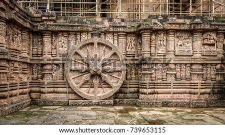 Intricate carvings on a stone wheel in the ancient  Hindu Sun Temple at Konark, Orissa, India. 13th Century AD