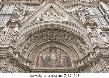 Intricate designs on the building facade of the Duomo in Florence, Italy