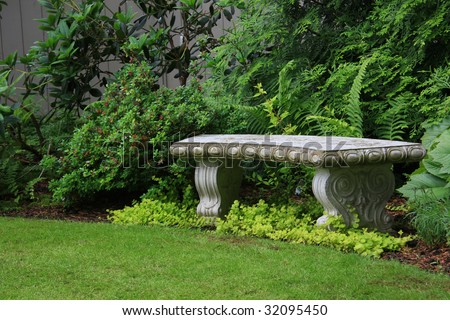 Intricate granite bench in a beautiful garden setting, also available in vertical.
