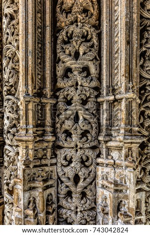 Intricate stone carvings on the walls of the Unfinished Chapels in the 14th century Batalha Monastery in Batalha, Portugal, a prime example of Portuguese Gothic architecture, UNESCO Heritage site #743042824
