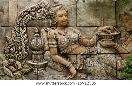 Intricate Thai carving mural - travel and tourism.