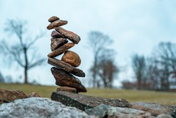Intricately balanced cairn in Rockefeller State Park in New York State
