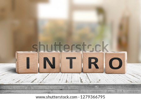 Intro sign made with wooden cubes in a bright room on a table #1279366795