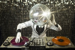introducing mr discoball. a cool club character DJing in a club