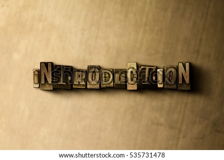 INTRODUCTION - close-up of grungy vintage typeset word on metal backdrop. Royalty free stock illustration.  Can be used for online banner ads and direct mail.
