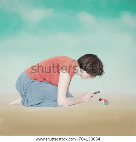 Introspection, psychology concept. Self knowledge. Woman examining her own self under magnifying glass. Filtered image.