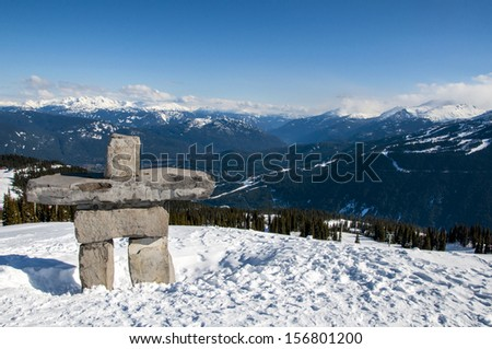 Inukshuk on top of a sunny Whistler Mountain