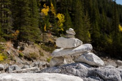 Inukshuk stacked stones Native American landmark at the Grotto Canyon Trail hike. Rock traditional pyramid direction marker used by Indigenous people