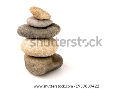 Inuksuk close-up. Round stones superimposed on each other. Place for your text Stock photo ©