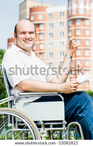 Invalid on the background of a new home - stock photo