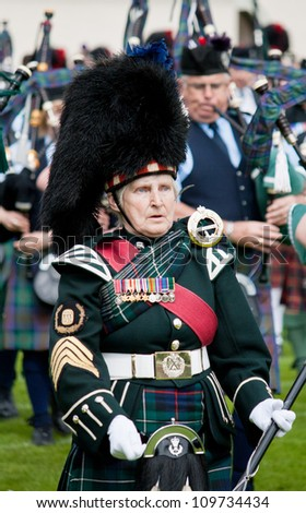 INVERNESS, SCOTLAND - JULY 21: An unidentified Band Leader takes part in the annual Inverness Highland Games in Inverness, Scotland on July 21, 2012. - stock photo