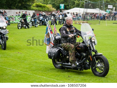 INVERNESS, SCOTLAND - JULY 21: Unidentified biker from The Royal British Legion at the annual Inverness Highland Games & Armed Forces Day celebrations on July 21, 2012 in Inverness, Scotland