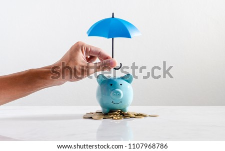 Investing and saving money during the rainy season concept, object on marble table top counter.