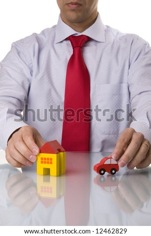 investment agent showing a house and a car, isolated with reflection