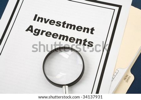 Investment Agreement and Magnifying Glass, business concept