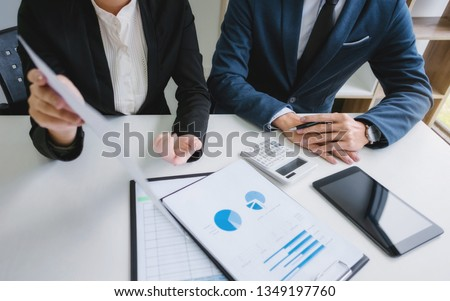 Investment and cooperate concept, business financial inspector analyzing about parformance data in office meeting. #1349197760