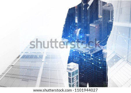 Investment, broker and economy concept. Businessman on abstract city background with forex chart. Double exposure
