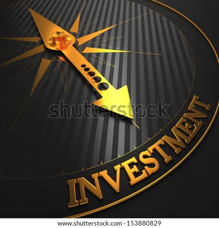 Investment - Business Background. Golden Compass Needle on a Black Field Pointing to the Word