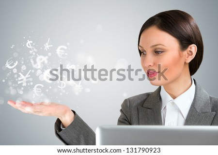 Investment concept. Pretty business woman with currency symbols.