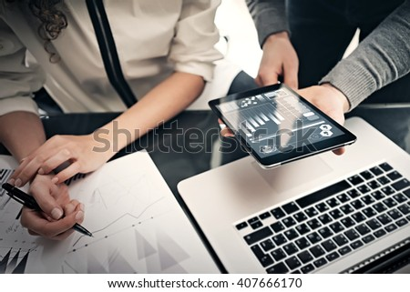 Investment department working process.Photo finance manager showing reports modern tablet screen.Statistics graphics screen.Private banker holding pen for signs documents, business project.Horizontal #407666170