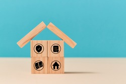 Investment insurance. Life and house protection. Insurance policy concept. Wooden cubes with sign on ground. Copy space