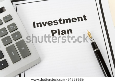 Investment Plan and pen, business concept