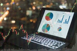 investment portfolio on screen laptop computer with index stock market and chart with uptrend stock market graph.