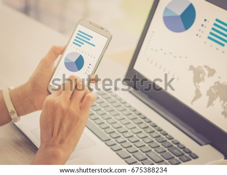 Investor analyzing stock market investments with financial dashboard, business intelligence on smartphone and computer screens / soft focus picture / Vintage concept #675388234