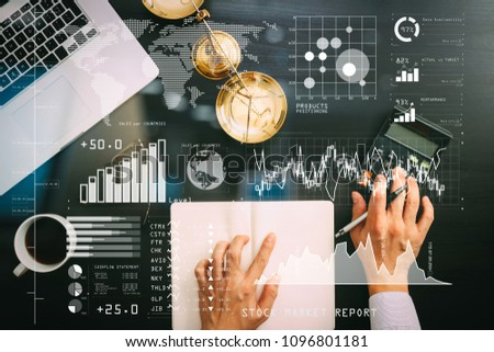 Investor analyzing stock market report and financial dashboard with business intelligence (BI), with key performance indicators (KPI).justice and law concept.businessman or lawyer or accountant works