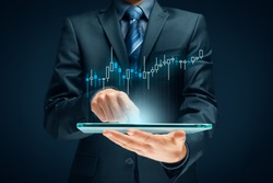 Investor and trader concept - investor with tablet and tradeview graph.