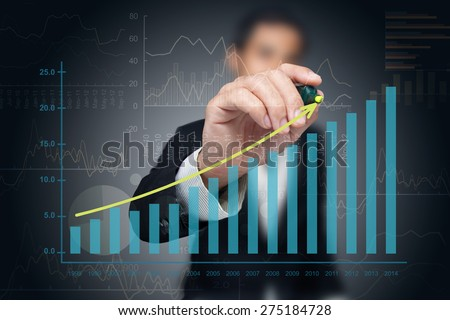 investor with growth chart of...