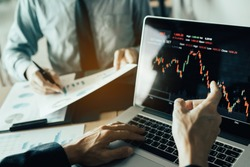 Investors are pointing to laptops that have investment information stock markets and partners taking notes and analyzing performance data.