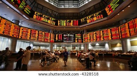 Investors monitor stock market prices.