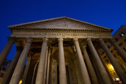 Invincible - Front of the Pantheon during the evening, highlighting tall columns, deep blue sky, carved front. Rome, Italy