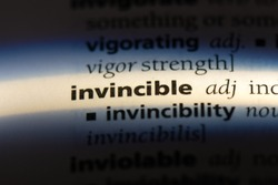invincible word in a dictionary. invincible concept.