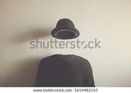 invisible man wearing black bowler, surreal concept of absence of identity Stockfoto ©