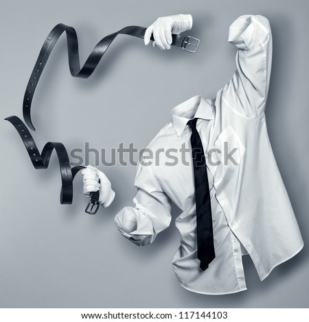 Invisible Man with two leather straps in the hands of