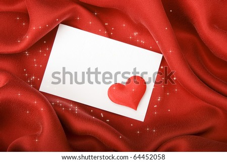 Invitation card on red silk satin background.
