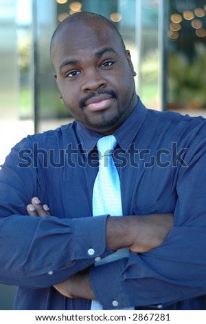 Inviting and friendly portrait of a young black minister