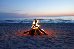 Inviting campfire on the beach during the summer, bring back fond memories.  Fun and good times at the lake.