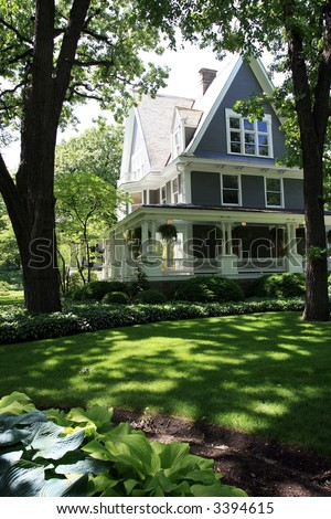 Inviting Front Porch on a Tree Lined Street, Oak Park, Illinois - stock photo