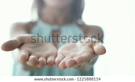 Inviting invitation Gesture by young woman opening palms #1225888114