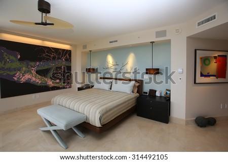 Inviting, upscale master bedroom in a high rise condominium.