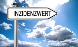 inzidenzwert - incidence value: corona virus new infections, german text on road sign