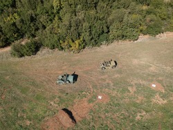 ioannina aerial view kalpaki village greece konitsa unarmed rusty abandoned and destroyed army vehicles jeeps of world war 2 greek army after the italian intrusion to epirus drone photos