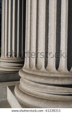Ionic Columns on a New York City courthouse. - stock photo