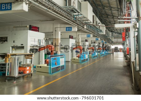 iot smart industry 4.0 concept. Automation industrial robotic arm working in operation machine zone in factory and Robot show data oee, plc status by using augmented mixed virtual reality technololgy #796031701